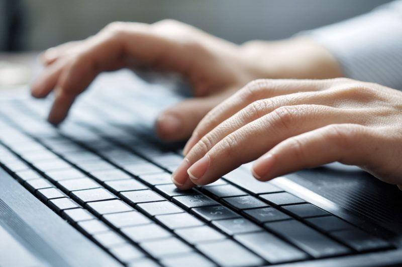 Close-up-of-fingers-typing